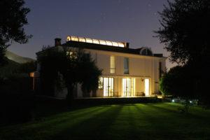 Modern illuminated house in the dark